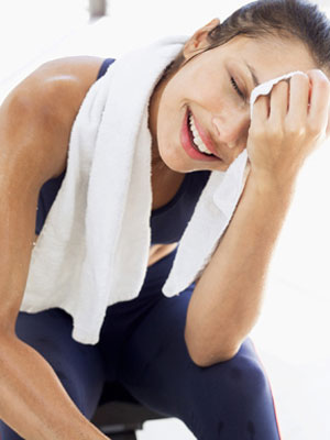 woman sweating- home remedies for excessive sweating