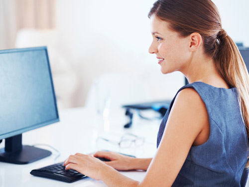 Woman on laptop-Losing Weight When Genes Work Against You
