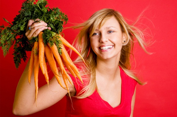 woman carrots rich in beta carotene- what it is all about