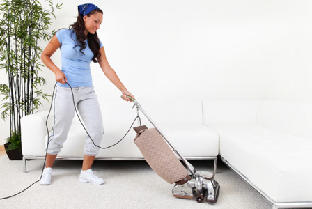 Woman-vacuuming How To Get Fit Without Stepping Into The Gym