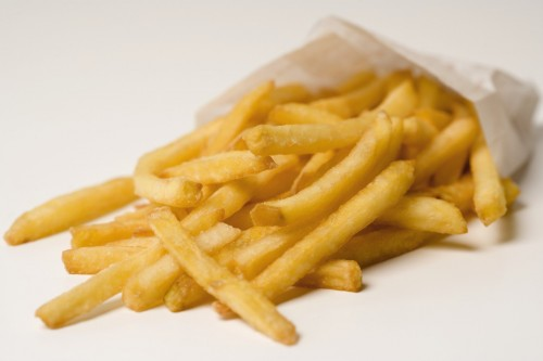 French fries spilling out of paper bag