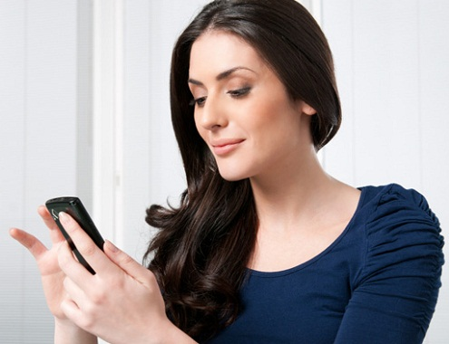 Woman using phone-Ways To Stop Getting Distracted By Mobile Phones