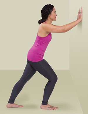 Person doing calf stretch exercise standing.