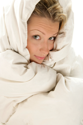 ways to ward off winter laziness- woman in blanket