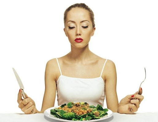 Health obsession, woman eating food
