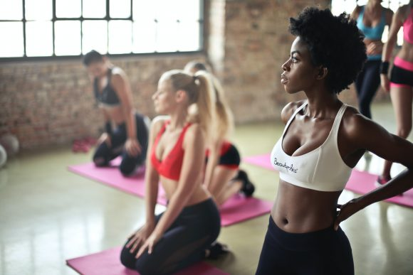 Weight Loss Workout Plan Woman working out in a gym
